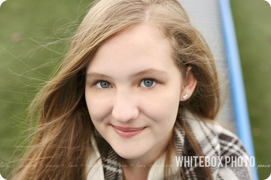 sami's senior portrait session in downtown greensboro by whitebox photo.